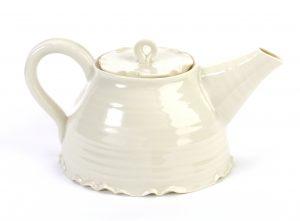 hand thrown porcelain tea pot in satin cream glaze