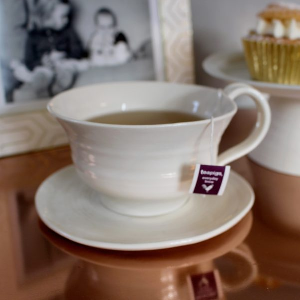 Hand thrown porcelain Tea Cup and Saucer in satin cream glaze