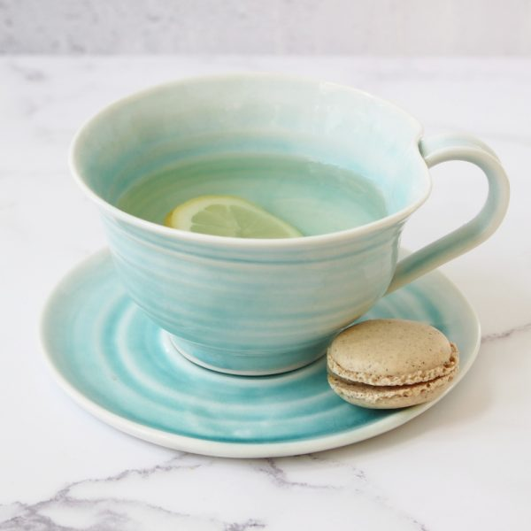 hand thrown porcelain tea cup and saucer