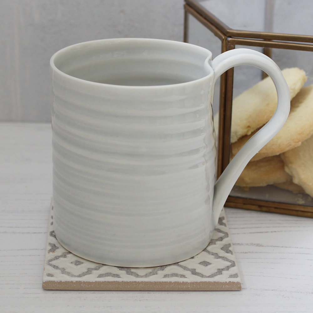 Tall porcelain coffee mug